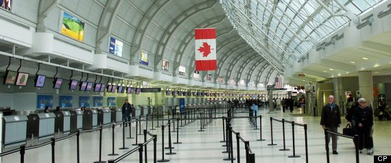 PREMIUM -- Travellers walk through Terminal 3 at Pearson International airport in Toronto on April 5, 2004. Opened in 1991, Terminal 3, combined with the new Terminal 1, will have the capability of serving 50 million passengers annually. (CP PHOTO - Steve White)